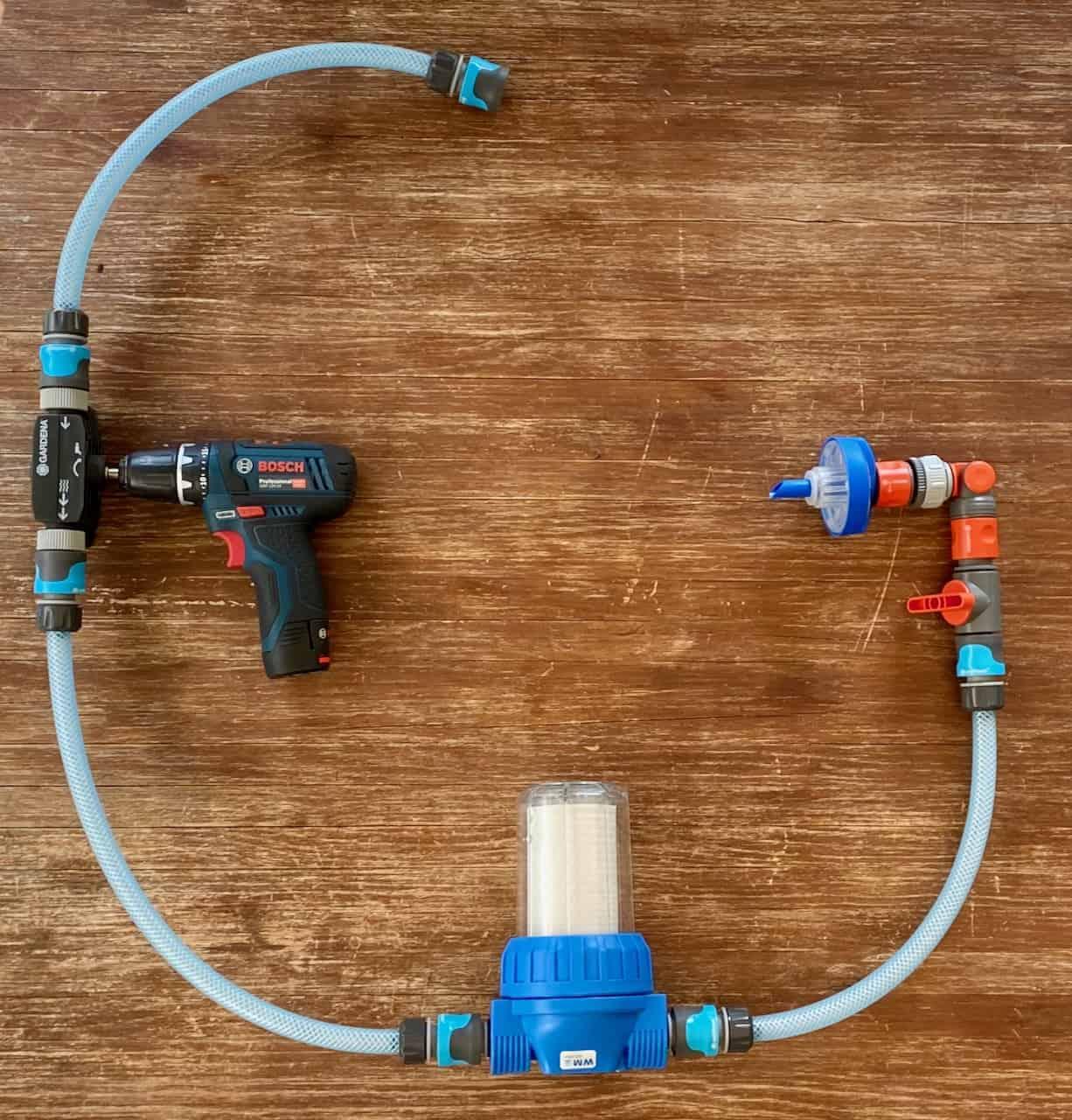 Wasserversorgung-Wassertanken-Heosoltution-Heoswater-Gardena-Wassertankkonstruktion-Bohrmaschinenpumpe-Akkubohrer-Wasserschlauch